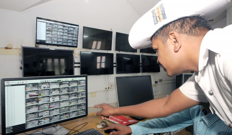 Traffic police constable pradeep seen monitoring the CCTV footages at the Control Room