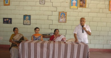 Mr. R Guru addressing the gathering on the occasion of  Women's Day. Ms. Indira, Ms. Savitha Shenoy and Ms. Meera others seen in  the picture