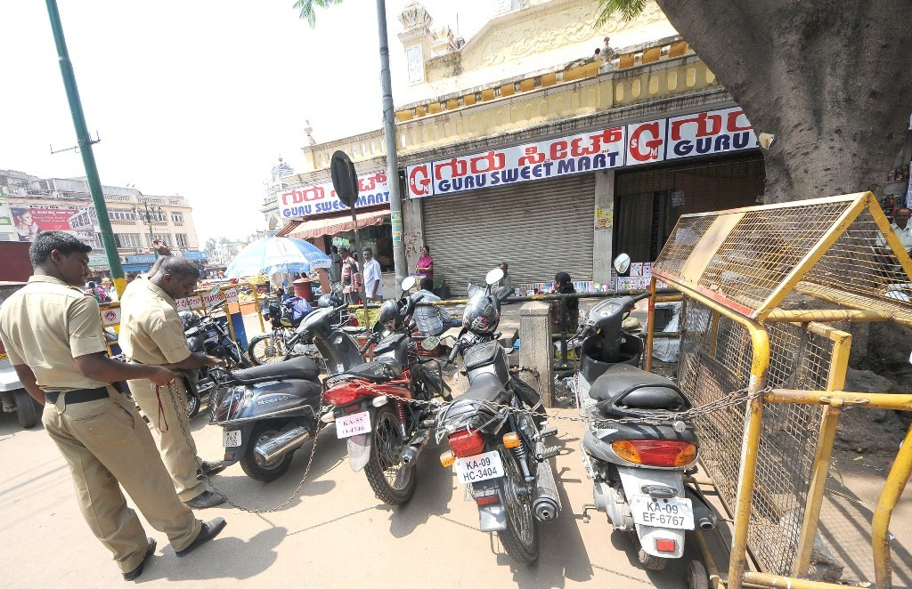 Policemen tie the vehicles with iron chains to prevent two wheeler thefts on the busy Sayyaji Rao Road on Wednesday