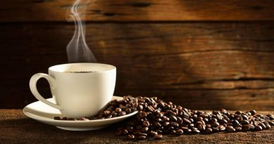 coffee-cup-and-beans-wood-background