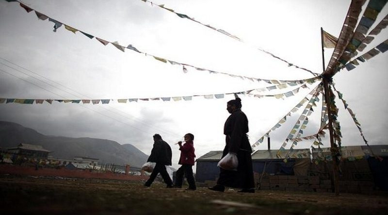 """Members of an ethnic Tibetan family walk along a makeshift camp for people affected by the 2010 earthquake in Yushu, Qinghai province, April 23, 2012. Government officials are threatening to forcibly relocate some 600 people - mostly Tibetans - from what was prime real estate in order to rebuild Gyegu - known in Chinese as Yushu - as what officials billed as an """"ecological tourism centre"""". The move has triggered resentment as two of China's most volatile social issues - land grabs and perceived mistreatment of ethnic minorities - combine to raise tensions and threaten social stability in the region. Picture taken April 23, 2012.       To match Feature CHINA-TIBET/EARTHQUAKE      REUTERS/Carlos Barria (CHINA - Tags: DISASTER SOCIETY) ATTENTION EDITORS 13 of 28 IMAGES FOR PACKAGE """"TIBET EARTHQUAKE - TWO YEARS ON"""""""