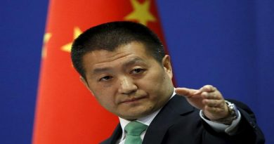 Chinese Foreign Ministry spokesman Lu Kang points out a reporter to receive a question at a regular news conference in Beijing, October 27, 2015. The U.S. Navy sent a guided-missile destroyer close to China's man-made islands in the disputed South China Sea on Tuesday, drawing an angry rebuke from Beijing, which said it warned and followed the American vessel. REUTERS/Kim Kyung-Hoon