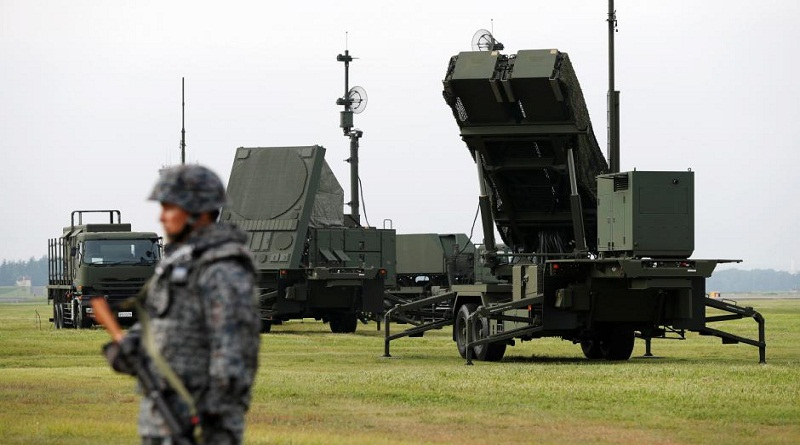 A Japan Self-Defense Forces (JSDF) soldier takes part in a drill to mobilise their Patriot Advanced Capability-3 (PAC-3) missile unit in response to a recent missile launch by North Korea, at U.S. Air Force Yokota Air Base in Fussa on the outskirts of Tokyo, Japan August 29, 2017.   REUTERS/Issei Kato