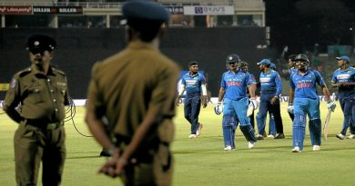 Cricket - Sri Lanka v India - Third One Day International Match - Pallekele, Sri Lanka - August 27, 2017 - Two police officers stand guard as India's MS Dhoni and Rohit Sharma walk off the field after winning the match. REUTERS/Dinuka Liyanawatte