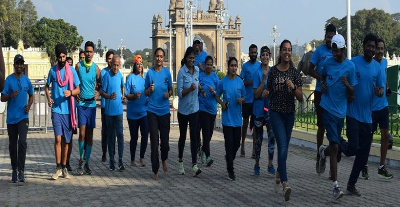 Image result for latest images of 148km run from Bengaluru to Mysuru to promote gender equality